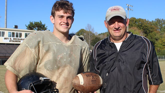 Wayne County quarterback Preston Rice, left, has thrown for 2,333 yards with 31 touchdowns this season. His dad Rick Rice is Wayne County's coach.