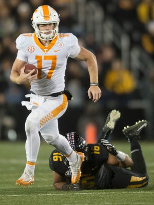 Tennessee quarterback Will McBride (17) runs with the ball as Missouri defensive lineman Marcell Frazier (16) attempts to take him down during a game between Tennessee and Missouri at Faurot Field in Columbia, Missouri, on Saturday November 11, 2017.