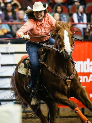 Bridget Carr races around the barrels during the 2nd performance of the San Angelo Stock Show and Rodeo Saturday, Feb. 3, 2018, at Foster Communications Coliseum.