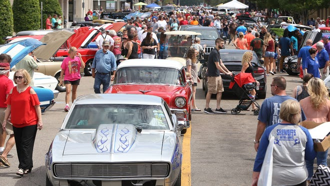 Visitors and classic cars fill downtown Gulfport, Miss., during their View The Cruise on the first day of Cruisin' The Coast in Gulfport, Miss., Sunday, Oct. 2, 2016.