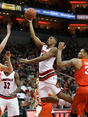 U of L's Donovan Mitchell, #45, soars in for a score against Syracuse during their game at the KFC Yum! Center.Feb. 17, 2016