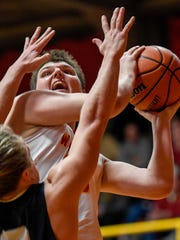 Mater Dei's Tyler Phelps (42) shoots over Reitz's Isaiah Dunham (13) as the Mater Dei Wildcats play West Side rival Reitz Panthers in a SIAC matchup at Mater Dei Friday, December 8, 2017.