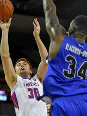 University of Evansville's Noah Frederking (30) shoots over Indiana State's Brandon Murphy (34) as the University's of Evansville Purple Aces play the Indiana State Sycamores at the Ford Center Wednesday, January 17, 2018.