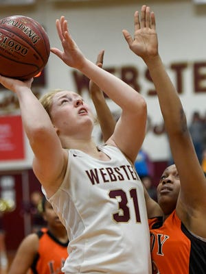 Webster County's Jessica Winders (31) shoots over defense from Hopkinsville's Jayla Rose (22) as the Webster County Lady Trojans play the Hopkinsville Lady Tigers in the Second Region semifinals in Dixon Friday, March 2, 2018.