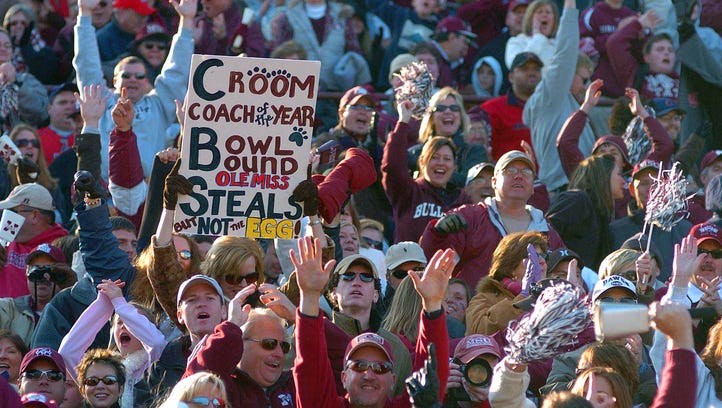 Mississippi State players (from left) Anthony Littlejohn, Royce Blackledge, Jason Husband and Brandon Hart parade the Egg Bowl trophy after winning against Ole Miss 17-14 in Starkville in 2007.