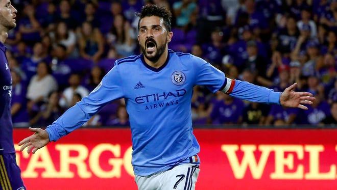 New York City FC's David Villa celebrates a goal against Orlando City SC at Orlando City Stadium. This was Orlando's first home loss.