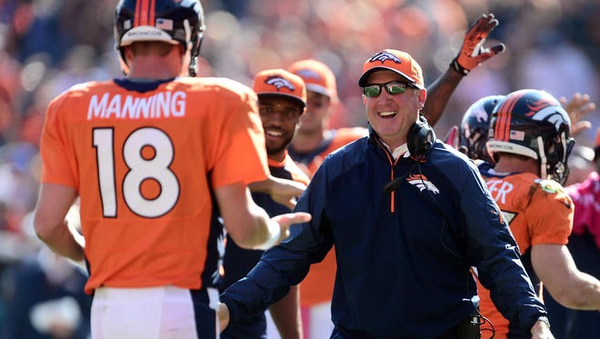Denver Broncos coach John Fox reacts to a touchdown pass by quarterback Peyton Manning  against the Jacksonville Jaguars at Sports Authority Field at Mile High in Denver on Oct. 13, 2013.