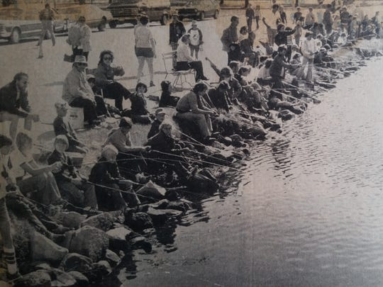 Families fish the shore of Lake Winnebago during the first Walleye Weekend in 1978.