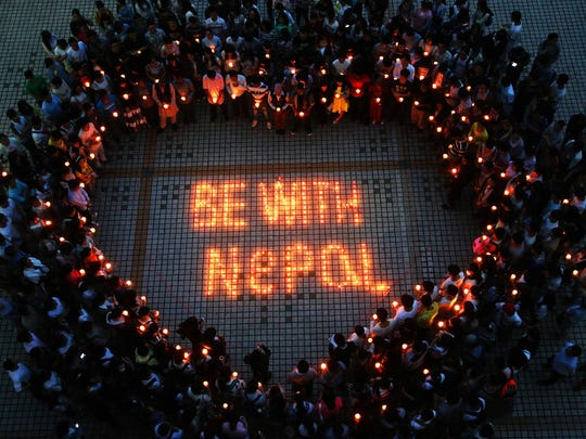 Nepalese students and Chinese students gather to pray for Nepal in Nanhua University in Hengyang, central China's Hunan province. International rescue teams and relief supplies began arriving in Nepal's devastated capital on April 27 to help terrified and homeless survivors of a quake that has killed more than 3,200 people in the impoverished nation.