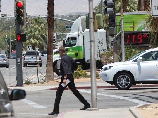 A man crosses the Portola in Palm Desert as a bank