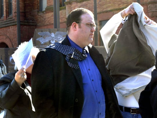 Jon White outside the Champaign County Courthouse in Illinois as his parents try to shield him from reporters after he plead guilty to eight charges of aggravated criminal sexual abuse in 2008.