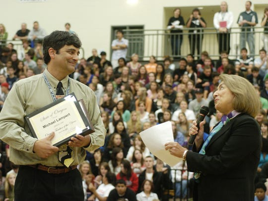 West Salem High School physics teacher Michael Lampert is congratulated by Susan Castillo, State Superintendent of Public Instruction, after being named Oregon Teacher of the Year in 2008.