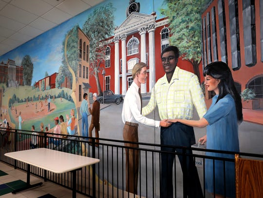 The original mural from the first Patterson Park Community Center, built in 1979, is on the wall at the new center, which opened 15 years ago.