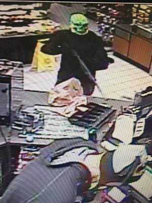 Security camera footage from Union 76 Station on Old Frontier Road shows a robbery in progress. Sheriff's Office Deputies arrested two suspects who fled the scene.