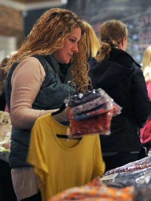 Michelle Gilbert, of Kimball Township, browses the tables Sunday, Jan. 31, during a boutique pop-up shop featuring LuLaRoe clothing by Suzy and Steph at Kate's Downtown.