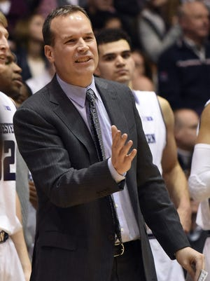 Northwestern head coach Chris Collins gives instructions to his team at Welsh-Ryan Arena.