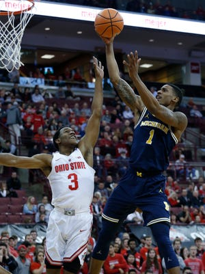 Michigan's Charles Matthews shoots over Ohio State's C.J. Jackson during the first half Monday in Columbus, Ohio.