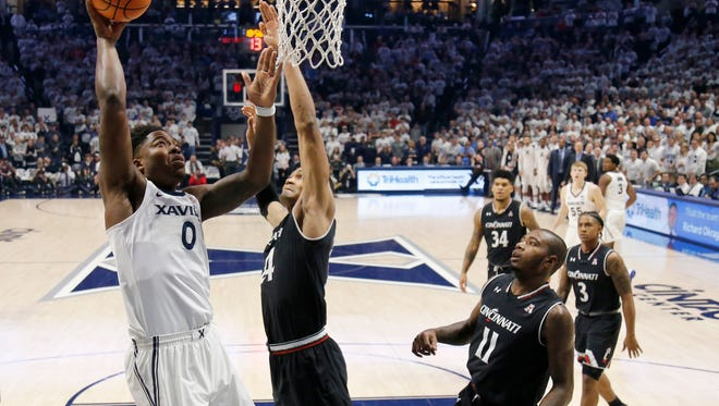 Xavier Musketeers forward Tyrique Jones (0) rises for a layup in the first half of the 85th Annual Crosstown Shootout game between the Xavier Musketeers and the Cincinnati Bearcats at the Cintas Center in Cincinnati on Saturday, Dec. 2, 2017.