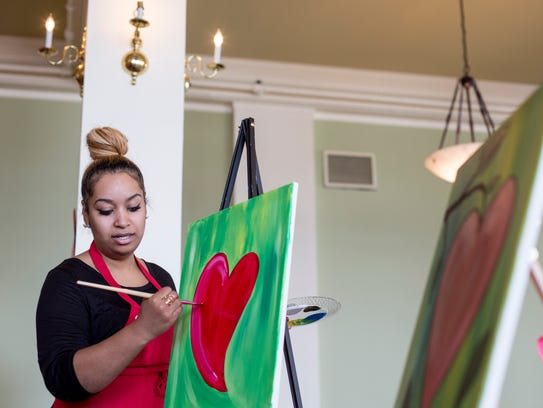 Instructor Siana Treece leads a therapeutic painting