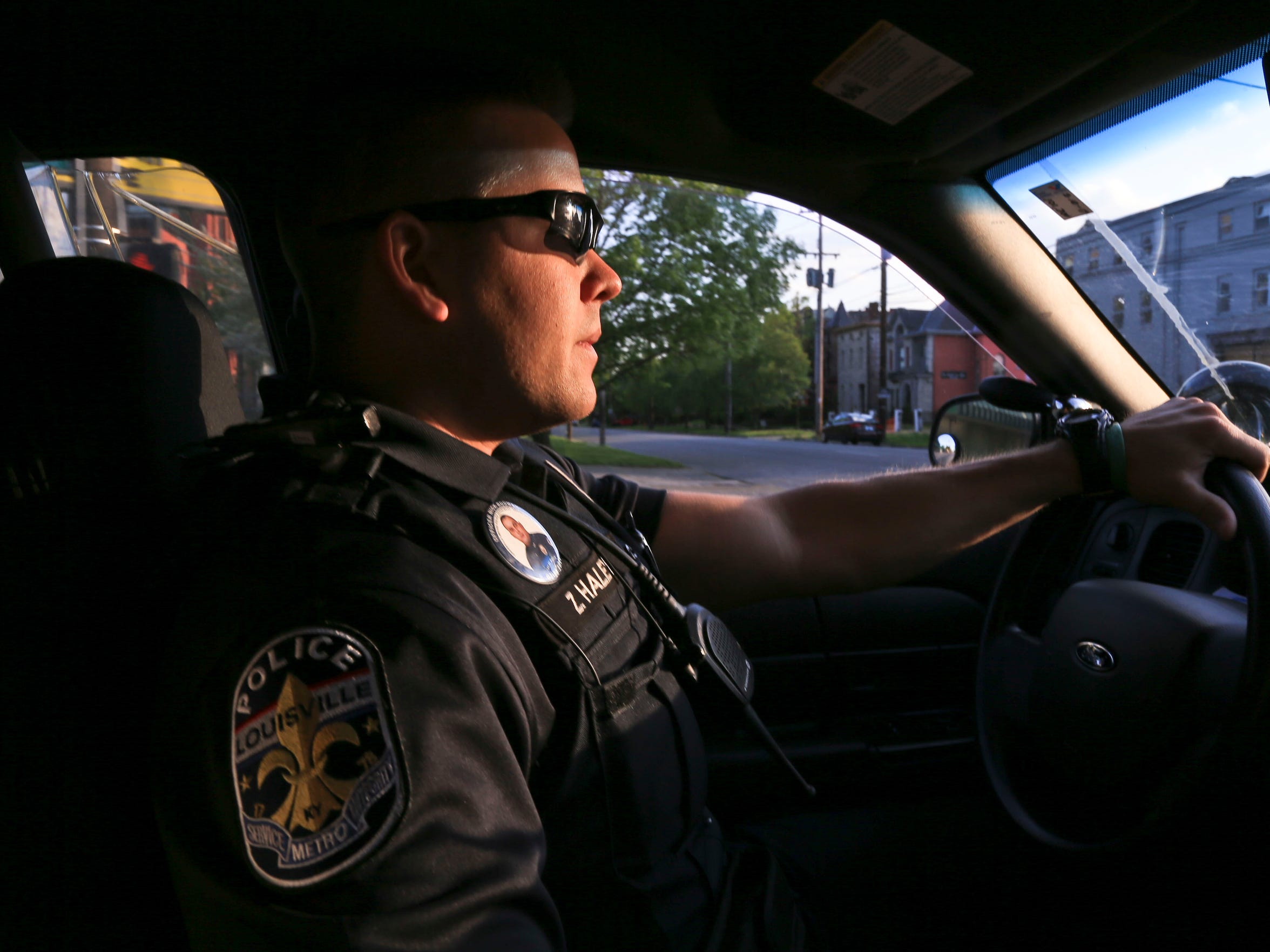 LMPD officer Zack Haley cruises through Old Louisville while on his 7 a.m. to 7 p.m. shift on a recent weekend. The Fourth Division is one of the busiest of the Louisville police divisions. He's had to respond to overdose calls frequently, sometimes up to two a night.