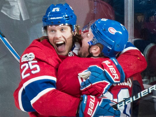 Montreal Canadiens' Jacob de la Rose (25) celebrates with teammate Nicolas Deslauriers after scoring against the Detroit Red Wings during the second period of an NHL hockey game, Saturday, Dec. 2, 2017 in Montreal. (Graham Hughes/The Canadian Press via AP)