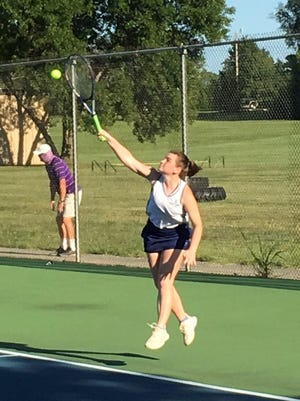 Hayden senior Allyson Meier serves the ball during a No. 1 doubles match Thursday at Hayden. Meier and Jenny Voegeli went 3-0 on the day.