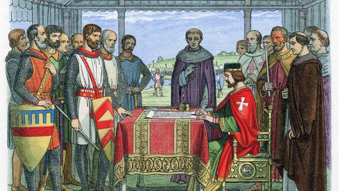 A depiction of King John signing Magna Carta in England in 1215.
