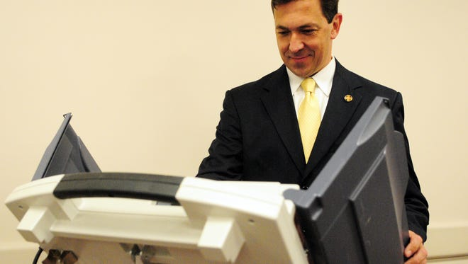 U.S. Senate candidate Chris McDaniel casts his ballot Tuesday morning at the George V. Harrison Multi-Purpose Center in Ellisville.