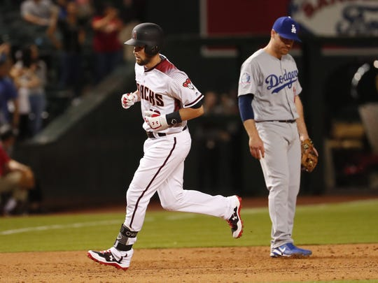 Arizona Diamondbacks center fielder Chris Owings (16) rounds the bases after hitting a game-tying three-run home run against the Los Angeles Dodgers during the ninth inning at Chase Field.