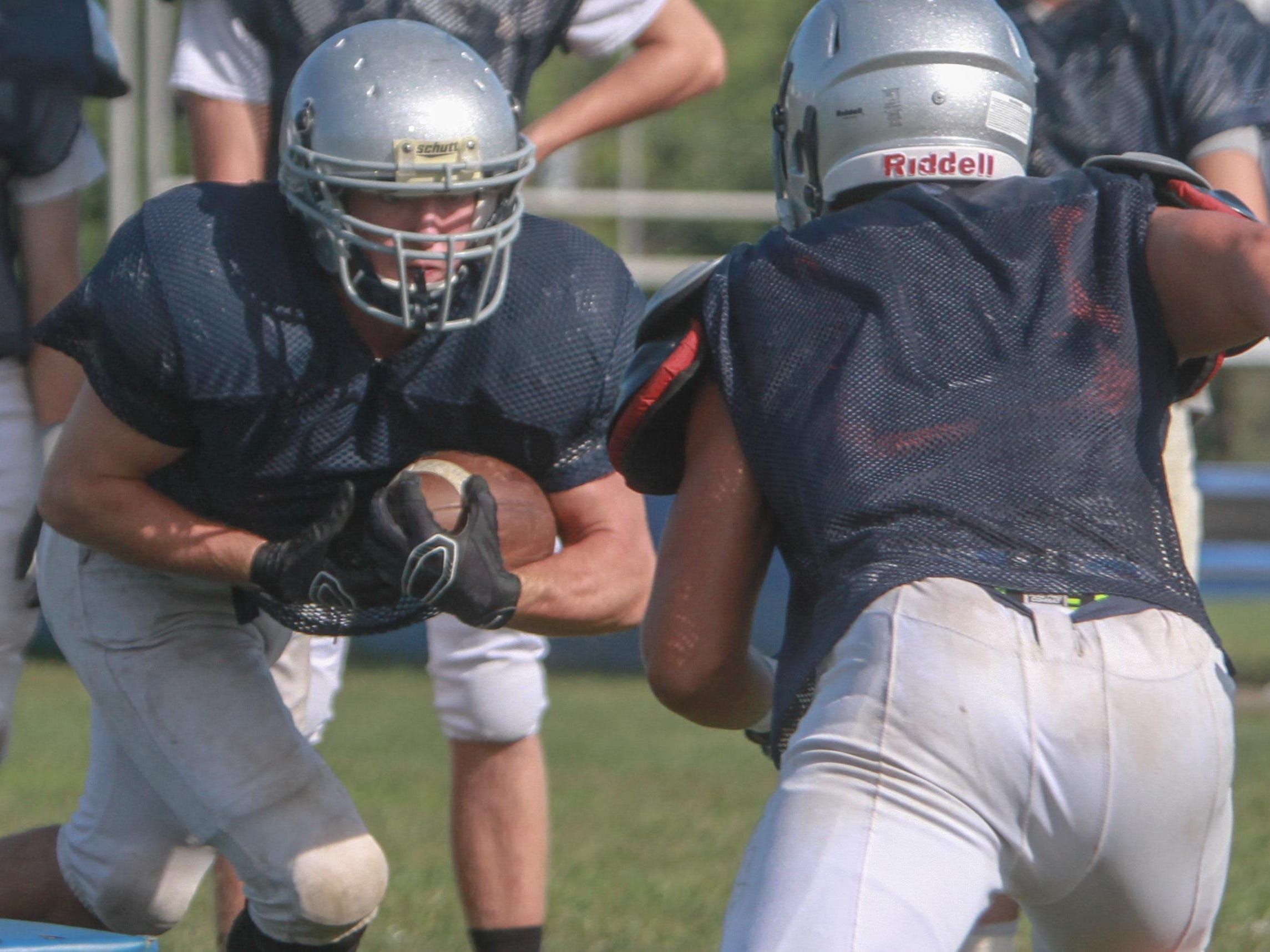 Paul Krueger takes the handoff for Manasquan during practice this summer.