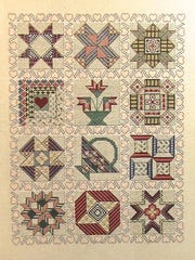 "Star pattern cross-stitch by Gen Follingstad, part of the ""Scandia Friends and Family"" exhibit at Meadows Art Gallery."