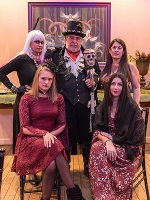"""Dressed as witches and warlocks for the Treasure Coast Wildlife Center's annual """"Ghoula"""" fundraiser Oct.28 are, from left, Melissa Zolla, Dan Martinelli, Stacy Ranieri, Jordan Pinkston, and Tiffany Smith."""