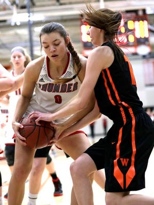 Seymour High School's Hailey Oskey, left, battles for a rebound against West De Pere High School's Brehna Evans during the Division 2 sectional semifinal girls basketball game Thursday, March 1, 2018, at Kaukauna High School in Kaukauna, Wis.