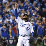 Fans stand during the National Anthem before Game 1 of the Major League Baseball World Series between the Kansas City Royals and the New York Mets Tuesday, Oct. 27, 2015, in Kansas City, Mo. (AP Photo/Charlie Riedel)