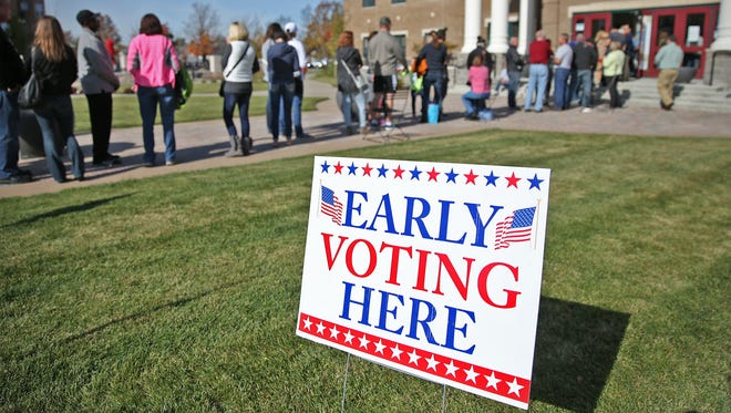 Voters wait up to four hours for the chance to vote early at the Fishers City Hall, Saturday, Nov. 5, 2016.