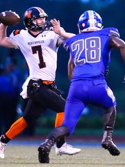 Northville quarterback Jack Burke (7) makes the pass