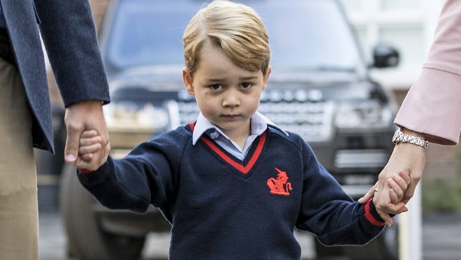 Prince George arrives for his first day of school in London, Sept. 7, 2017.