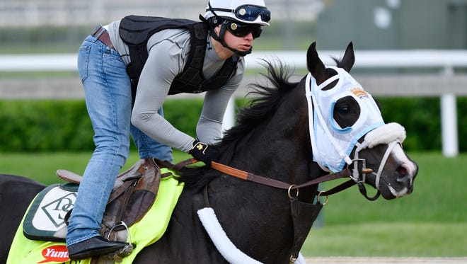 May 4, 2016; Louisville, KY, USA; Exercise rider Emerson Chavez works Kentucky Derby hopeful Tom's Ready during workouts in advance of the 2016 Kentucky Derby at Churchill Downs. Mandatory Credit: Jamie Rhodes-USA TODAY Sports