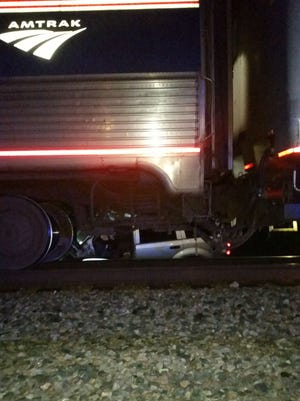 A 2007 Dodge Durango was struck by a train Monday morning in Dayton, Kentucky. The driver was transported with a broken ankle.