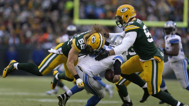 Green Bay Packers' Clay Matthews and Julius Peppers sack Detroit Lions' Matthew Stafford in the first quarter Sunday at Lambeau Field.