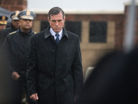 Gov. John Carney walks towards a plaque during a memorial ceremony for Lt. Steven Floyd at James T. Vaughn Correctional Center near Smyrna.