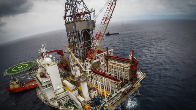 Offshore oil drilling rig or platform, aerial view, petroleum industry in the Gulf of Mexico.