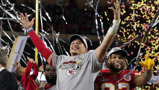 Kansas City Chiefs quarterback Patrick Mahomes, left, and defensive back Tyrann Mathieu celebrate after defeating the San Francisco 49ers in Super Bowl LIV on Feb. 2 in Miami Gardens, Fla. The Chiefs have five prime-time games this season.
