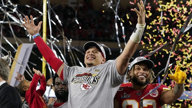 FILE - In this Feb. 2, 2020, file photo, Kansas City Chiefs' Patrick Mahomes, left, and Tyrann Mathieu celebrate after defeating the San Francisco 49ers in the NFL Super Bowl 54 football game in Miami Gardens, Fla.