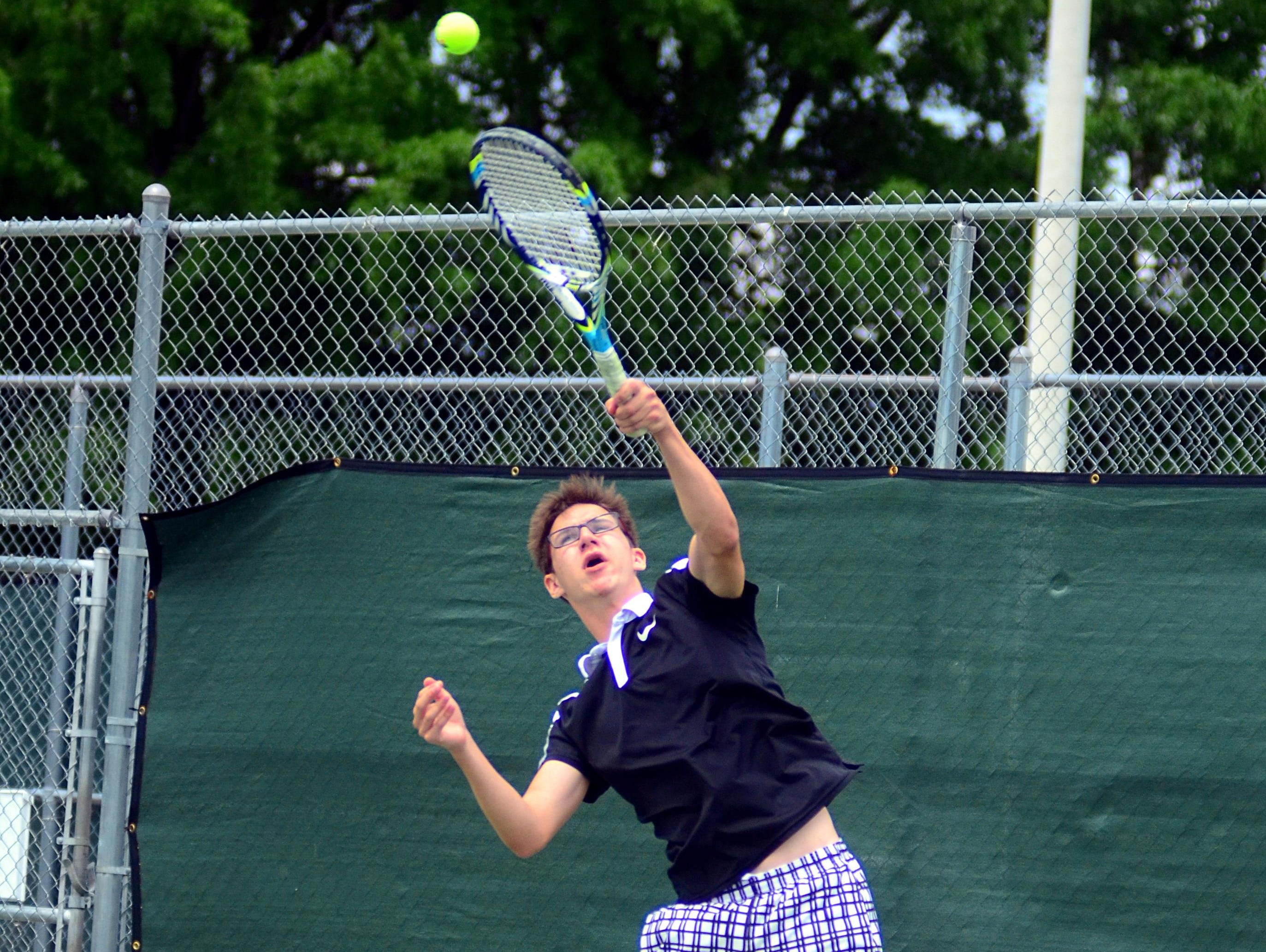 Hendersonville High senior Luke Jacob serves during his first-round singles match on Tuesday at the District 9-AAA Individual Tennis Tournament. Jacob advanced to the quarterfinals before suffering a straight-set loss to Station Camp senior Nathan Watson.