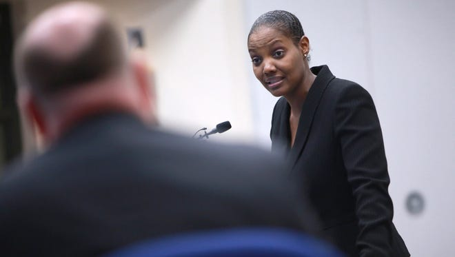 Shanari Williams, whose Bloomfield Hills Middle School eighth-grade son Phoenix Williams was bullied on a bus last month, speaks to the school board during the public comment section of a school board meeting at the Booth Center in Bloomfield Hills on Thursday, April 23, 2015.