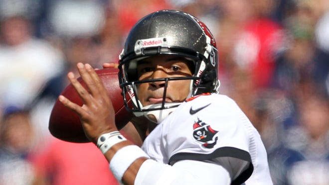 Tampa Bay Buccaneers quarterback Josh Freeman (5) drops back to pass against the New England Patriots during the first quarter of a game at Gillette Stadium.