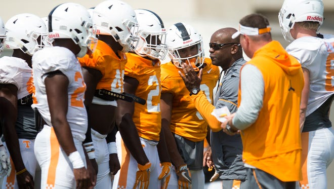 Vols defensive backs coach and special teams coordinator Charlton Warren, third from right, addresses players at practice Tuesday, Aug. 8, 2017.