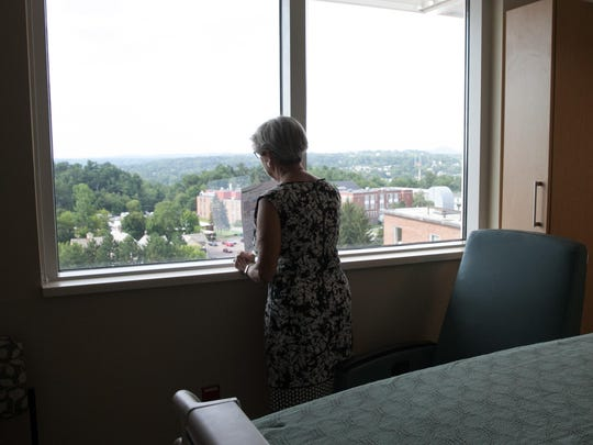 Lauriette Winters, looks out the window of a private room during a tour of the new Glen and Rosemarie Wright Mother Baby Unit at UVM Medical Center on Tuesday.
