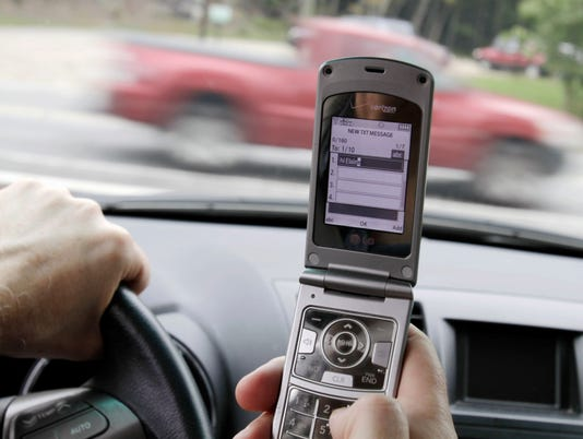 Drivers talk on cell phones less but surf, e-mail more